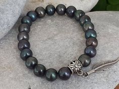 Items similar to Christmas gift Black Pearl Jewelry, Ocean Inspired Natural Stone, Natural Black Pearl Bracelet, Feather Mens Bracelet on Etsy Black Pearl Jewelry, Bracelets For Men, Leather Bracelets, Leather Necklace, Etsy Jewelry, Jewlery, Love To Shop, Pearl Bracelet, Natural Stones