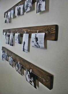 Wand mit Holzleisten schwarz weiße Fotos