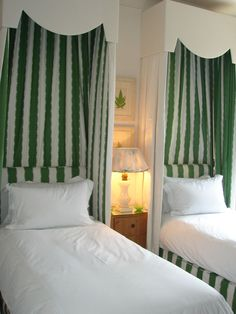 Love these... great green and white stripe, lining the canopies, and used for the headboards. Fun!