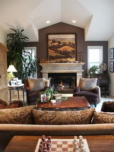White fireplace, brown painted wall above fireplace mantle. Elegant, stylish. Home Decor design.