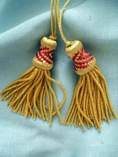 2   ANTIQUE FRENCH PASSEMENTERY  GOLD  METALLIC AND RED SILK  TASSELS