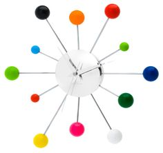 Spider Wall Clock: Twelve arms of various lengths are decorated with multicolored stainless steel balls. #Clock #Spider_Clock