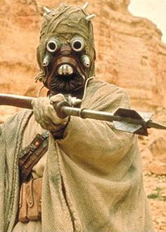 A Tusken Raider from Star Wars. The fierce nomads, also known as sandpeople, keep to themselves but are dangerous when provoked. They live in the Jundland Wastes of Tatooine.