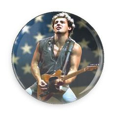 Bruce Springsteen was just a working class hero trying to make his way in the world with his music. Celebrate the dream that we all can hit it big like he did with this rockin' button. Each pin back b
