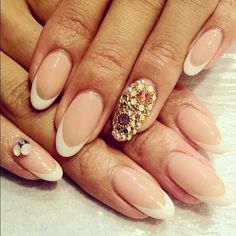 Jewels on French tips. Beautiful almond shaped nails!