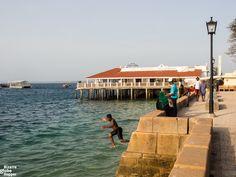 Kids jumping of stone wall of Forodhani Gardens, Stone Town, Zanzibar African Vacation, Stone Town, Alleyway, Tour Guide, Tanzania, Globe, Gardens, Tours, Beach