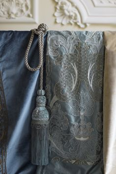 Our Caligari couture fabric is a dramatic baroque design, illuminated with delicate filigree embroidery in gold and silver threads. Paired here with the Bianca tassel tie back creating a look of delightful opulence! Tassel Curtains, Blue Curtains, Mode Pastel, Flower Room Decor, Elegant Curtains, Luxury Curtains, Baroque Design, Pillow Inspiration, Crafts Beautiful