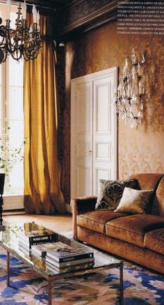 """""""Jacques upholstered the walls in a bronze jacquard fabric and juxtaposed the Flemish Chandelier with a carpet of his own design which I had made by Jan Kath in Nepal"""" says Parker. The crystal 19th century wall chandelier came from Les Puces de Paris Saint-Ouen Flea Market. Jacques Grange Voque Living Australia 7"""