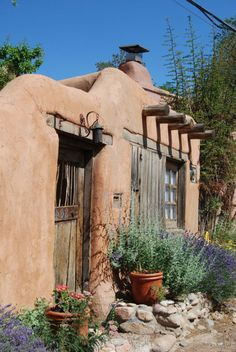 Flowers, adobe wall, and weathered door. Santa Fe, New Mexico, USA (color) Southwest Decor, Southwest Style, Exterior Paint Colors, Paint Colors For Home, Paint Colours, Exterior Design, Adobe Haus, New Mexico Style, Santa Fe Style