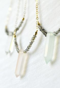 Pastel gemstone spike necklaces with flashing labradorite beads. Great for layering. By Kahili Creations of Hawaii...