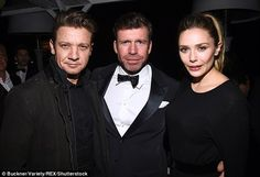 Close pals: On her arrival to the party, Elizabeth struck up a series of poses for photographers before heading inside to rub shoulders with her co-star, actor Jeremy Renner - the pair are no strangers to each other as they previously starred alongside one another for The Avengers