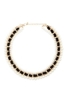 A layered collar necklace featuring rows of faux pearls and a row of velvet wrapped in a curb chain with a lobster clasp closure.