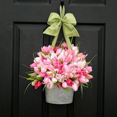 Welcome Guests! Pretty pink tulips overflowing its contain and hung on the front door by a pale green ribbon. Such a cute idea from ciao! Newport Beach