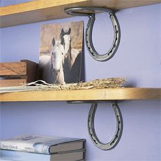 Horseshoe shelf brackets! Used this pin as an inspiration- had a friend weld horseshoes and I spray painted them myself. Hubby drilled bigger holes for screws and I stained a pine board to make my shelf. Looks awesome!