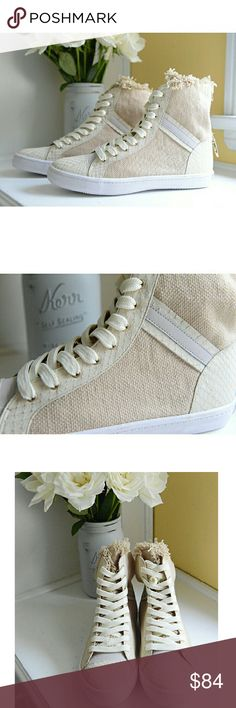 Rebecca Minkoff Tan High-top Sneakers I love these! They're fresh and clean looking, for a casually well-dressed polish. They're made of natural and putty hued canvas uppers, feature a round toe and a decorative gold clasp at the heel that can be worn connected or not. Brand new, never worn! Rebecca Minkoff Shoes Sneakers