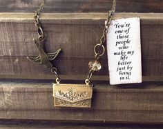 Secret Message Envelope Necklace  ~ This vintage-like necklace is a fun way to send a message to someone special. It will be a sweet surprise when they realize this brass envelope really opens and holds a hidden message inside. Adorned with neutral crystal bead and an adorable brass bird charm delivering the message.  Envelope is slightly under and inch wide, and the necklace length can be made in any length.  Delivered in a small linen bag, perfect for gifting! Can be mailed directly to…