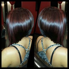 Dark red violet with red highlights and graduated bob haircut created by Geneva Rygel