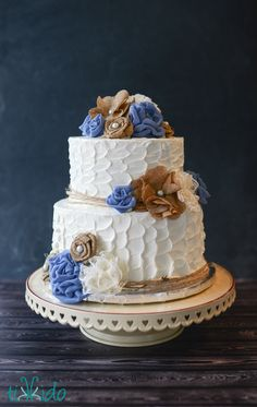 Rustic wedding cake with burlap, lace, and fabric flower accents. The bride's sister made the flowers, and the blue fabric is actually left over from the bridesmdaids' dresses!