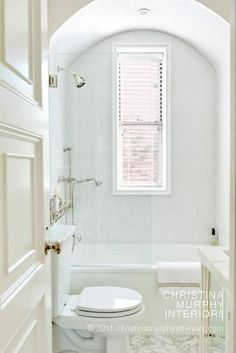 Beautiful small bathroom...I've never understood the need for a long window in here. A high horizontal one would be so much more practical, although maybe not as aesthetically pleasing.