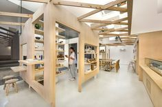 PRODUCE intersects two retail spaces with plywood planes in singapore