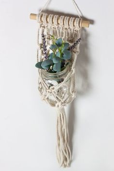 This DIY Hanging Macramé Planter is pretty amazing. It's a simple DIY to help you store your cute little succulents in your home. They make great gifts too!