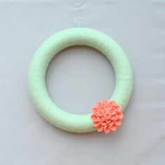 Mint and Coral Yarn Wreath. Mint Summer Wreath with Salmon Coral Felt Dahlia Flower. Modern Spring Door Wreath with Felt Flowers. 12 Inches.. $43.00, via Etsy.