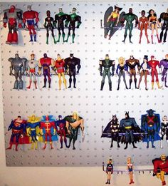 What a great idea! Peg board to display and store action figures!