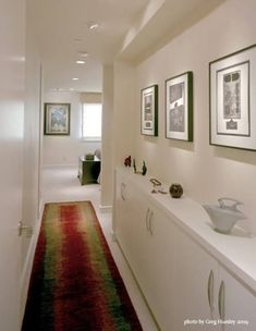 Clever use of space. Shallow cabinets with shelf for display make this otherwise narrow hallway more visually pleasing and functional. Long Hallway, Upstairs Hallway, Entry Hallway, White Hallway, Entryway, Hallway Cupboards, Hallway Cabinet, Hallway Shelf, Cabinet Space