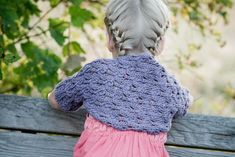 """A delicate yet durable and functional little bolero for baby and child. This lace quickly knits up flat with minimal seaming to form sleeves. Choose a soft organic cotton or super soft wool blend and this is sure to be a wardrobe favorite. Also available in an adult version: """"Generations"""""""