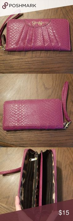 Jessica Simpson wallet with wrist strap Beautiful dark magenta/light plum wallet with wrist strap... EUC!!  It has 8 card slots, center coin purse, and 2 large cash/checkbook pockets. Very versatile and lovely... ready for a new home! Jessica Simpson Bags Wallets