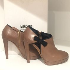"NEW Moschino Cheap & Chic Bow Booties New Moschino Cheap & Chic high heeled booties. Brown with gold zipper on the inside and a sexy keyhole with black grosgrain ribbon  detail on the outside. ALL leather. 4.75"" heel with a .5"" platform. Size 39 but fits like an 8 so I will list it as an 8 Moschino Shoes Ankle Boots & Booties"