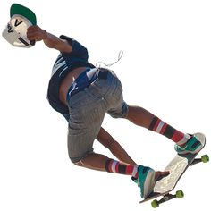 A young man skating through the air in jean shorts and stripedsocks.