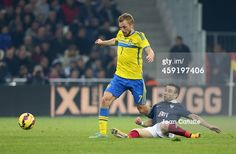 Sebastian Larsson of Sweden is tackled by Mathieu...