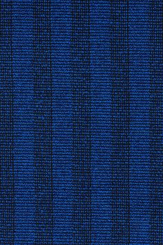 Pulsar from Kvadrat/Raf Simons's. The textile is an exploration of bouclé—a soft nubbly textile associated with high fashion tailoring—marrying it with the stripe theme.