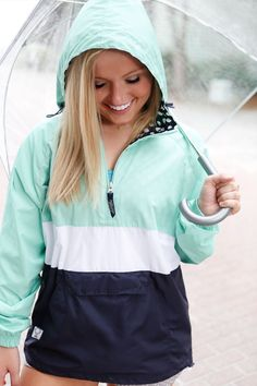 FEATURES: Wind & water-resistant polyester with Light weight breathable cotton lining for softness. Conveniently packs into its front pouch pocket for storage. Extended zipper above neck offers extra