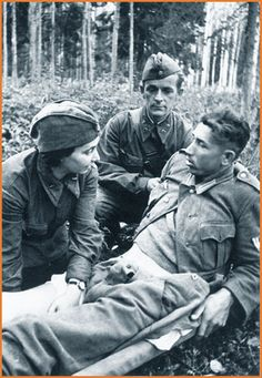 Attending to a wounded German POW,  July 1941 - The German soldier could be from a non German unit, recruited from captured territories by his appearance.