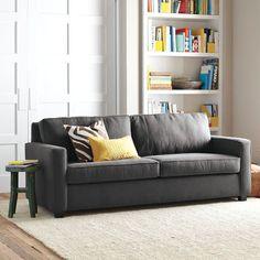 dark grey sleeper sofa, yellow, light carpet... perfect!