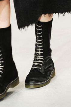 Calvin Klein: From combat and hiking boots to backpacks, utility accessories are on-trend for Fall 2014.