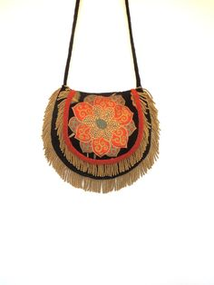 I've listened to Fleetwood Mac, since high school, and I have to say, I've never seen Stevie with a purse, perhaps she kept her cash some place else. I think tapestry bags  would be her favorite.