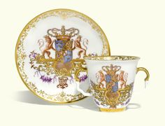 A Meissen armorial double handled beaker and saucer from the service for Queen Ulrika Eleonora of Sweden, circa 1732