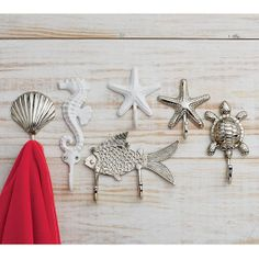 Seaside Towel Hooks   The Company Store -  Crafted of solid brass with a nickel-plated or white powder-coated finish, these sturdy wall hooks are ideal for keeping towels, swimsuits and other essentials organized.