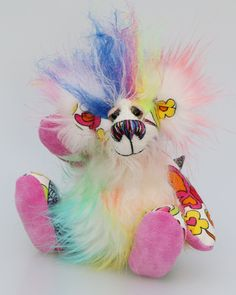 Flutterby is a wildly colourful and happy one of a kind artist bear made from floral print linen, mohair and faux fur by Barbara Ann Bears