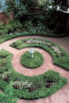 Formal beds and radiating bricks encircle a sundial. (Photo: Jerry Pavia)