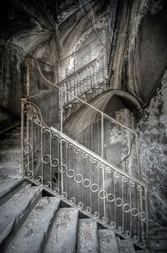 Staircase in Decay. I'm not a huge fan of the filters that some use on these old places. I would like to have seen it before the excessive editing in HR. But so beautiful nonetheless.
