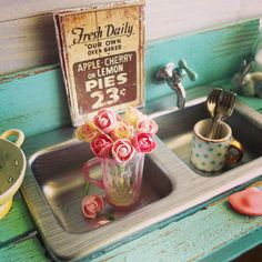 May I have this in non-miniature life? Miniature sink, flowers, and mug (with an amazing gold handle) by Kim Saulter.