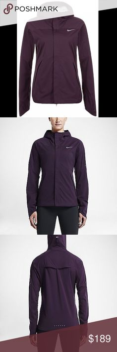 Nike Shield Running Jacket in Plum NWT-Benefits storm-fit fabric repels wind, rain and snow hood with interior knit lining. Zips up to your chin for comfortable coverage. Ergonomic seams for natural range of motion underarm zip vents and back vent help regulate your temperature. Fold-over mitt construction enhances warmth -front zip pockets with interior media pocket and cord solution--product details, reflective elements stand out in low light adjustable drop-tail hem enhances coverage…