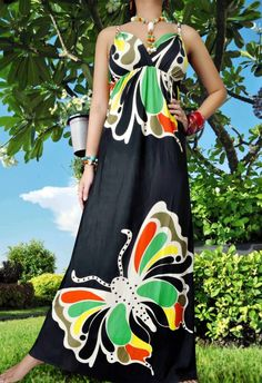 Would use a more toned down fabric. Butterflies aren't really my style. But I'm inspired to make this dress. I love the cut of it!