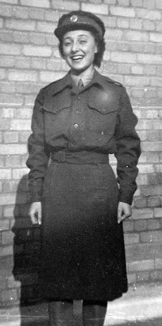 Woman in ATS uniform. Battledress blouse with service dress skirt ~