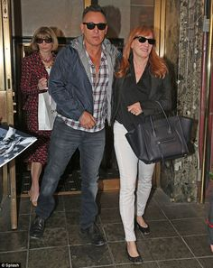 Photobombed by Anna Wintour! Clean-cut Bruce Springsteen and wife exit hotel at…