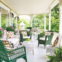 Cottage-Style Outdoor Spaces - I <3 porches...especially this one! The green furniture makes it pop.